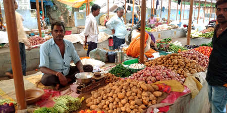 DISTRICT KATNI, INDIA - AUGUST 14, 2019: Asian village poor man selling potato at indian vegetable green fresh agriculture produce market. Editöryel