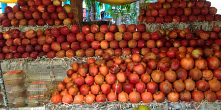 DISTRICT KATNI, INDIA - SEPTEMBER 04, 2019: Fresh red apple presented for sale at local street shop at asian agriculture produce goods market.