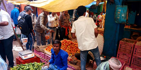 DISTRICT KATNI, INDIA - OCTOBER 13, 2019: Indian people crowd for buying vegetables at agriculture market.