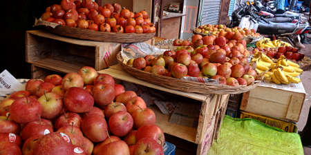DISTRICT KATNI, INDIA - OCTOBER 13, 2019: Fresh red apples presented on baskets at agriculture market in asian street.
