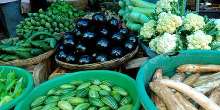 DISTRICT KATNI, INDIA - OCTOBER 13, 2019: Fresh greengrocery kept on baskets at vegetable market in asian street.