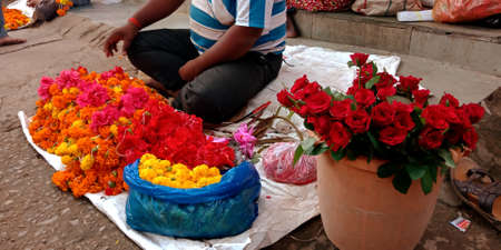 DISTRICT KATNI, INDIA - OCTOBER 13, 2019: An indian man selling flowers at hindu temple street store in village area. Editöryel