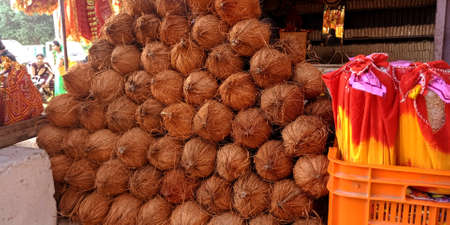 DISTRICT KATNI, INDIA - OCTOBER 13, 2019: Hindu religious coconut offerings displayed at temple street store in village area.