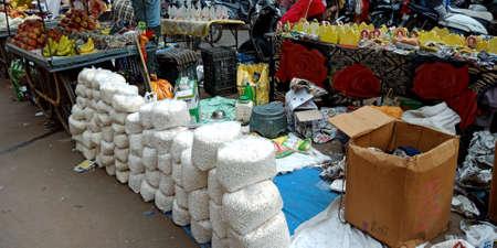 DISTRICT KATNI, INDIA - OCTOBER 19, 2019: Religious god offering displayed for sale on street bazaar shop during hindu diwali festival. Editöryel