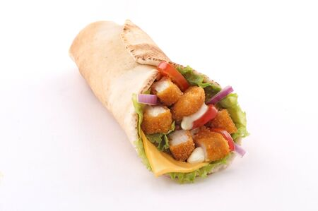 fried chicken wrap in pita bread with fresh vegetables and sauce on white background isolated