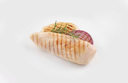 grilled chicken breast and onion with herbs and vegetables on white background
