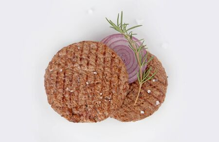 steak burger, minced meat grilled with spices and onion on white background top view