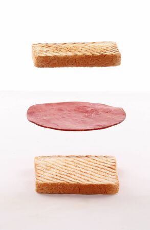 clubhouse sandwich, toasted bread and slice of ham float, fly on white background
