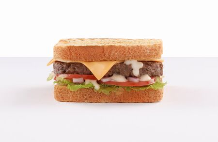 single and double beef burger with cheddar cheese and toast bread on white background