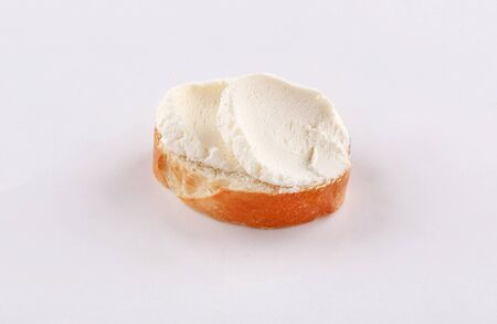 little baguette bread slice with spread cheese on white background