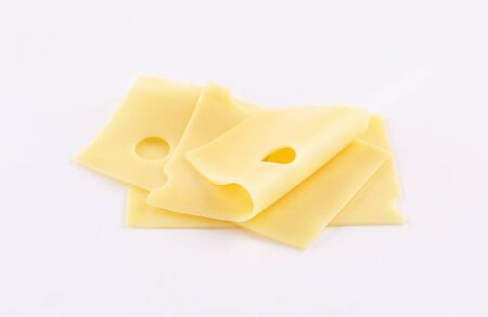 deli cheddar, gouda, emmental cheese slices on white background