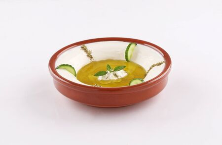 labneh traditional oriental dish, with herbs and cucumber, olive oil on white background 스톡 콘텐츠