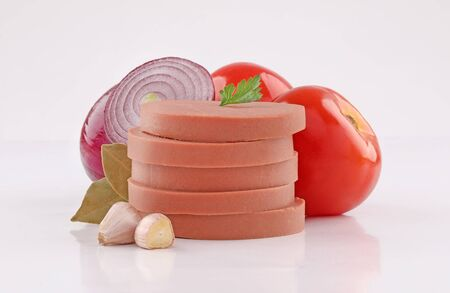 luncheon canned meat cuts, cold cuts, slices with vegetables on white background Stock Photo