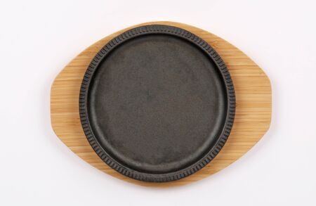 sizzling plate wood circular Clean and empty with three white dip top view isolated on white background