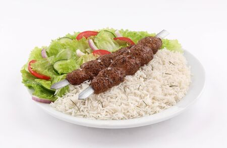 white dish two Skewer shish kebab meat with white rice and salad isolated on white background