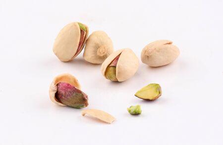 closeup Pistachio  nuts isolated on white background Zdjęcie Seryjne