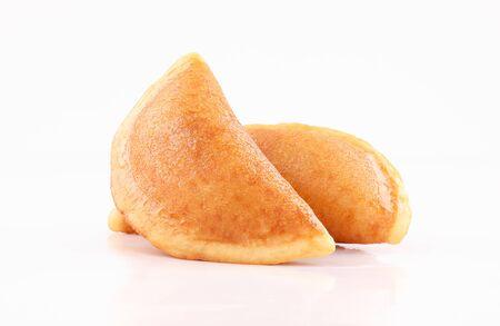 qatayef Ramadan Traditional Sweets stuffed cheese and nut jwz isolated on white background