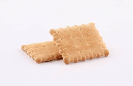 golden biscuits and sprinkled crumbs isolated on white background Zdjęcie Seryjne