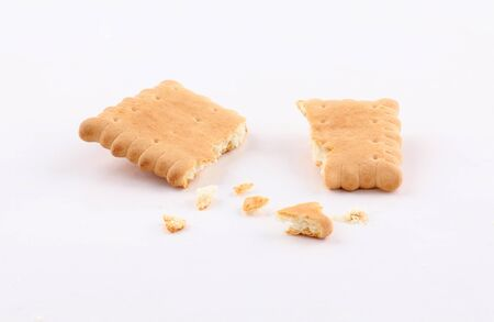 golden biscuits and sprinkled crumbs isolated on white background Stockfoto