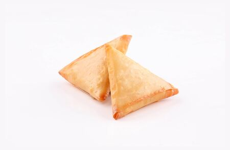 two Piece golden samosa stuffed isolated on white background