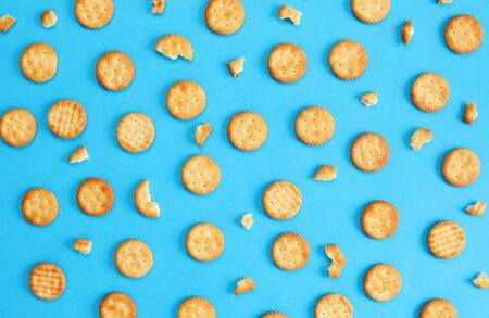 pattern biscuit crackers snacks on blue background top view