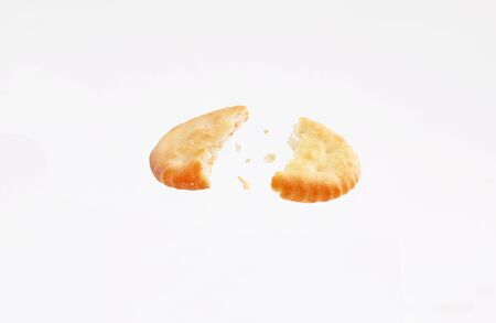 broken crackers biscuits fly isolated on white background