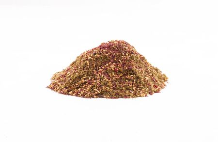 organic zaatar with toasted sesame, sumac mIddle eastern spices in a bowl isolated on white background