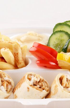close up chicken shawarma meal takeaway with tomato and fried potato Stockfoto