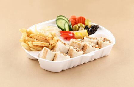 chicken shawarma meal one and half sandwich with appetizer, fried potato in shawarma box high view Foto de archivo
