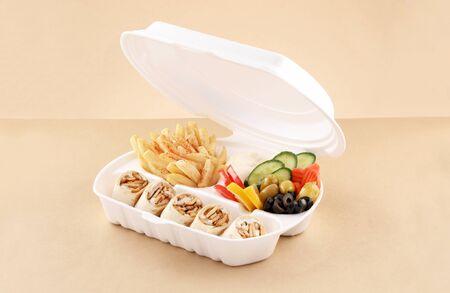 tortilla chicken shawarma meal single sandwich with appetizer and fried potato in shawarma box Stockfoto