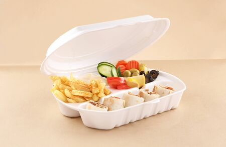 chicken shawarma meal single tortilla sandwich with appetizer and fried potato in shawarma box