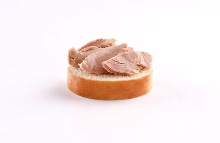 tuna on french bread, canape, spanish tapas isolated on white background