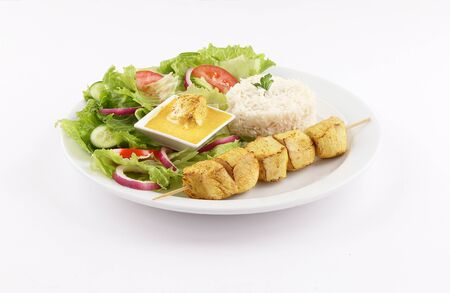 white dish Skewer shish curry tandoori with white rice and salad, dip curry sauce isolated on white background
