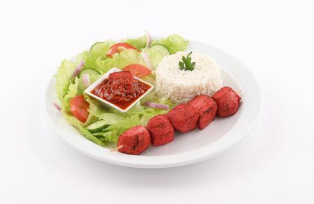 white dish Skewer shish paprika tandoori with white rice and salad, dip bbq sauce isolated on white background Stockfoto