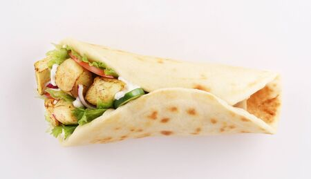 naan bread wrap sandwich shish taouk, curry tandoori with tomato and red onion, top view isolated on white background