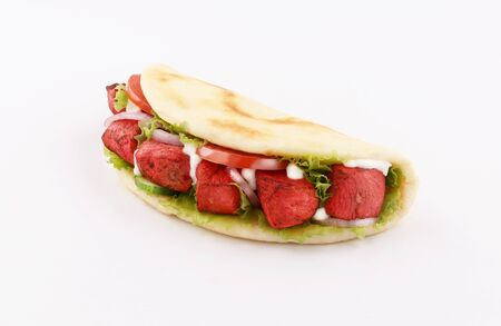 naan bread wrap sandwich paprika tandoori with onion and tomato, lettuce isolated on white background