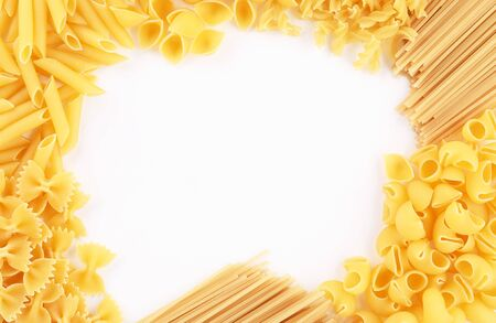 background various uncooked pasta fusilli, conchiglio, rigatoni, farfalle, penne top view