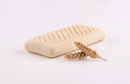 panini bread toasted with ears wheat low angle on white background
