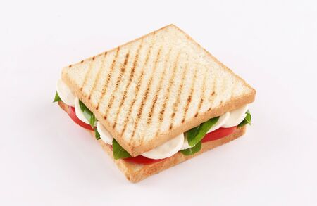 toast bread sandwich mozzarella cheese with basil and tomato isolated on white background