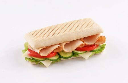 panini sandwich roast turkey with cheese and salad, tomato , lettuce isolated on white background Stockfoto