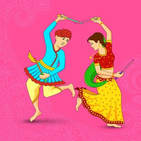 navratri: Man and woman dancing on Dandiya night