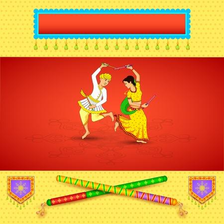 dussehra: Man and woman dancing on Dandiya night