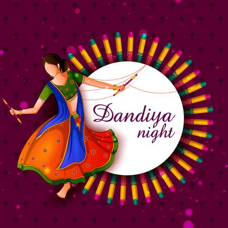 People playing traditional folk dance Garba on Dandiya night celebrating Navratri during Dussehra