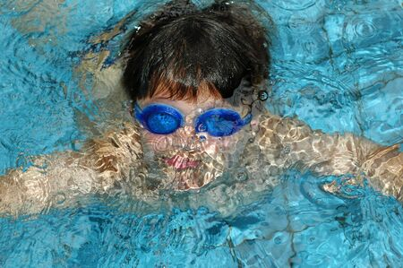 Boy  swimming under water with goggles Stock Photo - 693850