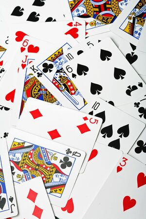un used: new, un-used playing cards in a random arrangement
