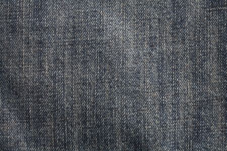 Dark blue stonewashed denim fabric. This image is photographed, not scanned. Stock Photo
