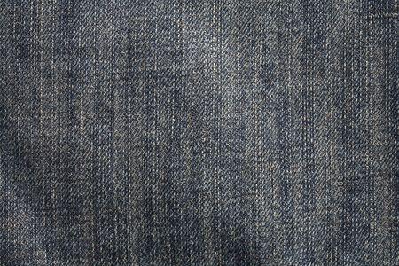 denim fabric: Dark blue stonewashed denim fabric. This image is photographed, not scanned. Stock Photo