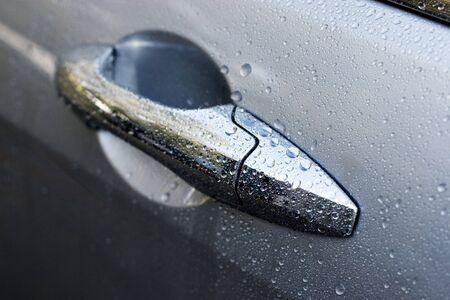 car door: Wet car door after a wash. Short depth-of-field. Stock Photo