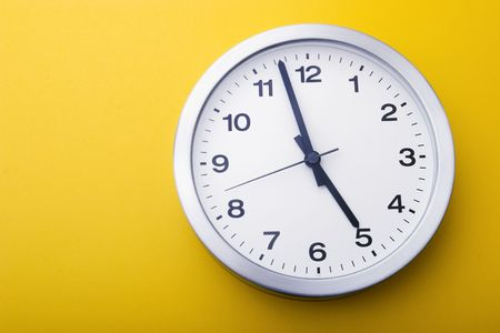 almost: The clock is almost five. Stock Photo