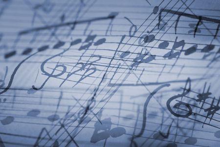 melodies: hand-written musical notation background.